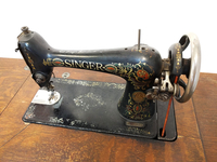 Image Vintage Singer Treadle Sewing Machine with Cabinet